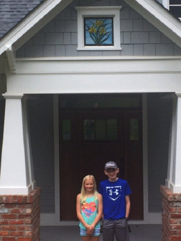 Seth and Skye standing under their new window.