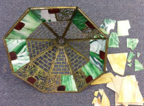 Damaged stained glass shade from bottom