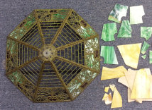 Damaged stained glass shade from top